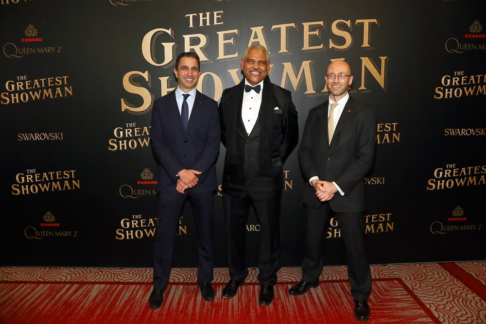 """Carnival Executives Josh Leibowitz, Arnold Donald, Simon Palethropeattends as Cunard Hosts World Premiere of 20 th Century Fox's """"The Greatest Showman"""" on board Greatest Ocean Liner, Flagship Queen Mary 2, on Friday, Dec. 8, 2017, in Brooklyn, N.Y. This is the first ever major motion picture premier to take place on board a passenger ship. (Photo by Stuart Ramson/Invision for Cunard/AP Images)"""