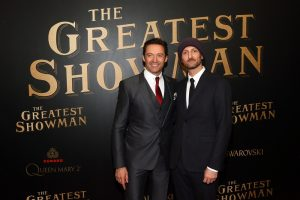 """Hugh Jackman, left, and Michael Gracey attend as Cunard Hosts World Premiere of 20 th Century Fox's """"The Greatest Showman"""" on board Greatest Ocean Liner, Flagship Queen Mary 2, on Friday, Dec. 8, 2017, in Brooklyn, N.Y. This is the first ever major motion picture premier to take place on board a passenger ship. (Photo by Stuart Ramson/Invision for Cunard/AP Images)"""