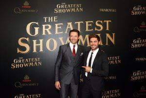 """Hugh Jackman, left, and Zac Efron attend as Cunard Hosts the World Premiere of 20th Century Fox's """"The Greatest Showman"""" on board Queen Mary 2 on Friday, Dec. 8, 2017, in Brooklyn, N.Y. This is the first ever major motion picture premier to take place on board a passenger ship. (Photo by Stuart Ramson/Invision for Cunard/AP Images)"""