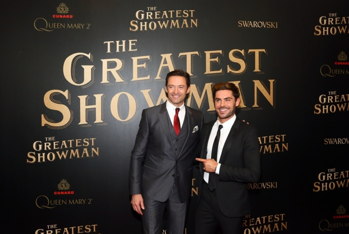"Hugh Jackman, left, and Zac Efron attend as Cunard Hosts the World Premiere of 20th Century Fox's ""The Greatest Showman"" on board Queen Mary 2 on Friday, Dec. 8, 2017, in Brooklyn, N.Y. This is the first ever major motion picture premier to take place on board a passenger ship. (Photo by Stuart Ramson/Invision for Cunard/AP Images)"