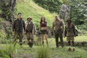 (l to r) Nick Jonas, Jack Black, Karen Gillan, Dwayne Johnson and Kevin Hart star in JUMANJI: WELCOME TO THE JUNGLE.